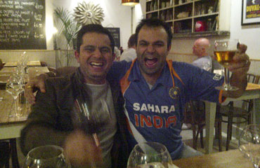 Reader Bankim Chandra and a friend celebrate India's win over a drink