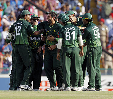 Pakistan's captain Shahid Afridi (3rd from left) is congratulated by teammates