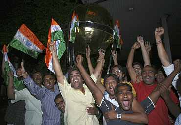 Fans celebrate in Hyderabad after India won the their World Cup semi-final against Pakistan