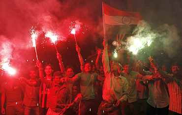 Fans in Ahmedabad celebrate India's victory over Pakistan