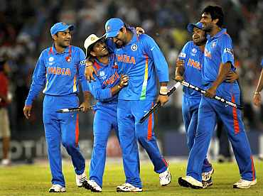 Indian players celebrate after winning the semi-final match against Pakistan