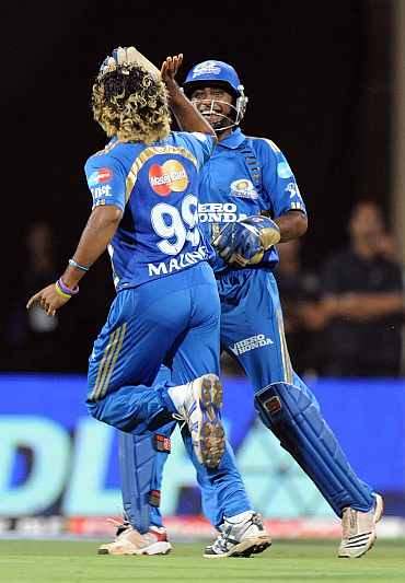 Lasith Malinga celebrates after picking up the wicket of Colin Ingram