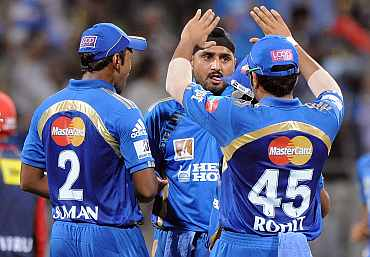 Harbhajan Singh celebrates after picking up David Warner's wicket