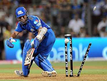 Tendulkar looks back after being bowled by Irfan Pathan