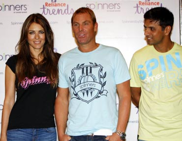 Rahul Dravid (right) with Shane Warne (left) and Liz Hurley
