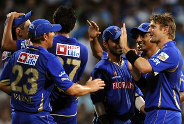 Shane Watson celebrates with team-mates the wicket of Ambati Rayudu