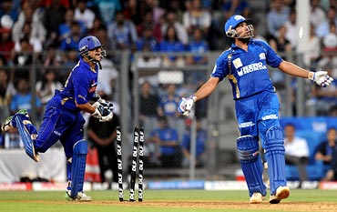 Rohit Sharma is stumped by wicketkeeper Pinal Shah off Shane Warne
