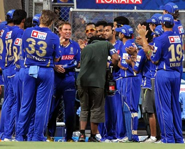 Shane Warne is cheered by his Rajasthan Royals team-mates