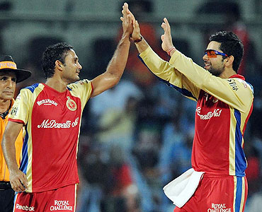 Syed Mohammad (left) celebrates with Virat Kohli