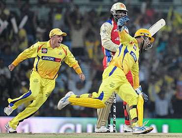 Chennai Super Kings captain MS Dhoni celebrates after the dismissal of Chris Gayle