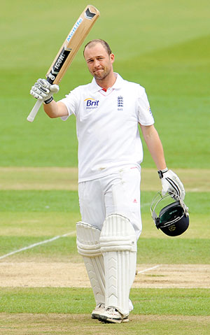 England's Jonathan Trott celebrates on reaching 150