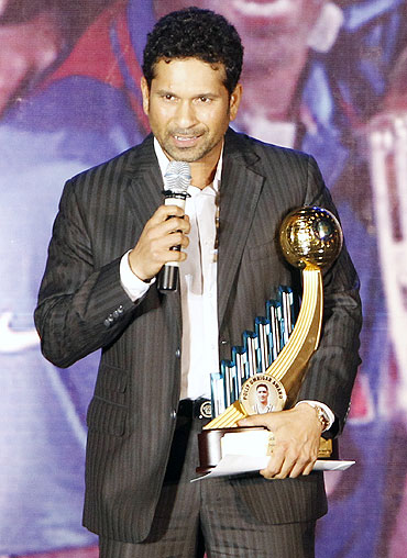 India's Sachin Tendulkar with India's Best Cricketer of the year award for the year 2009-10