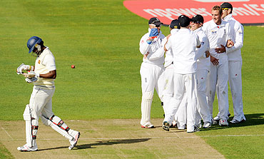 England celebrate after the dismissal of Sri Lanka's Thisara Perera