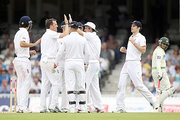 Graeme Swann (2nd from left) of England celebrates the wicket of Salman Butt