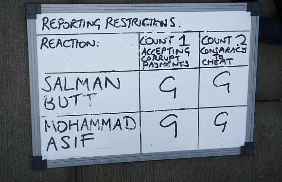 A whiteboard used by reporters shows that former Pakistan cricket captain Butt and cricketer Asif have both been found guilty