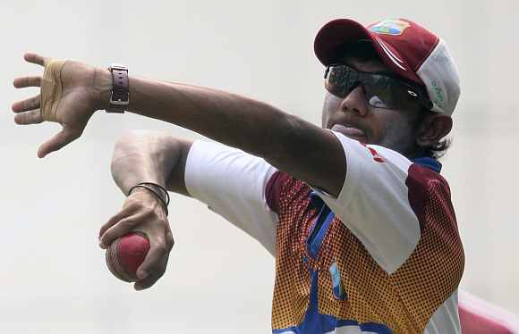 Devendra Bishoo in action during a practice session
