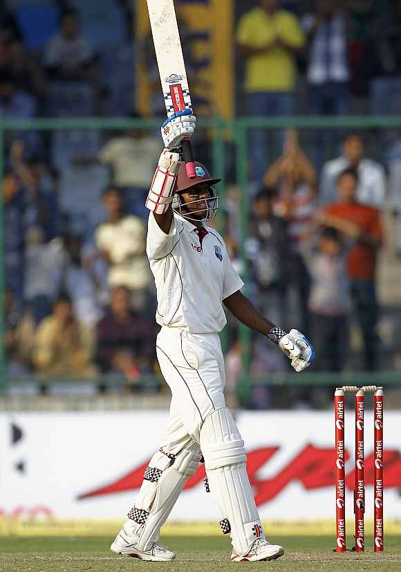 Shivnarine Chanderpaul celebrates after completing his century against India at Feroz Shah Kotla
