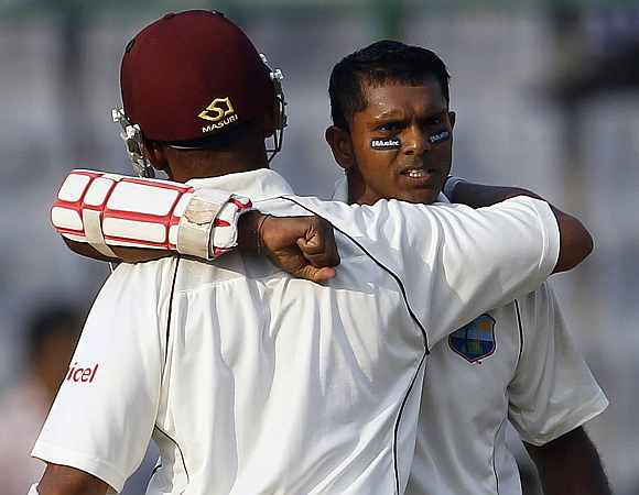 Shivnarine Chanderpaul celebrates after completing his century