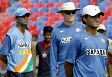 Greg Chappell, with Sourav Ganguly and Rahul Dravid