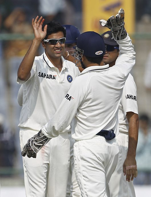 Ashwin gets a high-five from skipper M S Dhoni