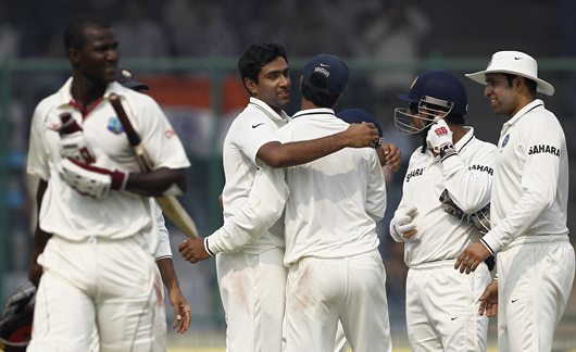 Ashwin is congratulated by teammates after dismissing West Indies captain Darren Sammy