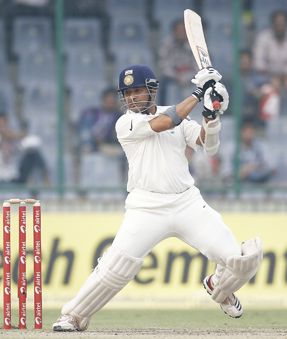 India's Sachin Tendulkar plays a shot during the third day of their first test cricket match against West Indies in New Delhi