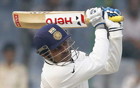 India's Virender Sehwag plays a shot during the third day of their first test cricket match against the West Indies in New Delhi