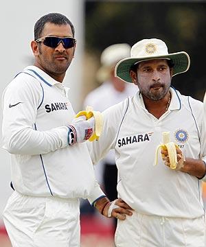 Dhoni with Tendulkar