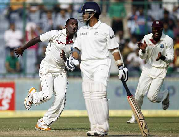 Fidel Edwards celebrates after picking Sachin Tendulkar's wicket in the 1st innings