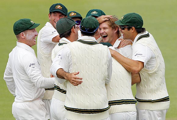 Australia's Shane Watson celebrates with team-mates after taking the wicket of South Africa's Ashwell Prince on Thursday