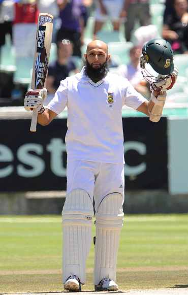 Hashim Amla celebrates after completing his century