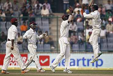 West Indies players celebrate after picking up a wicket
