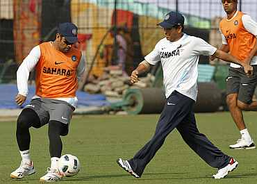 MS Dhoni plays football with Sachin Tendulkar during a practice session in Kolkata