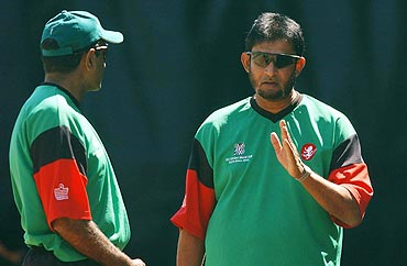 Former Kenya coach Sandeep Patil (right)