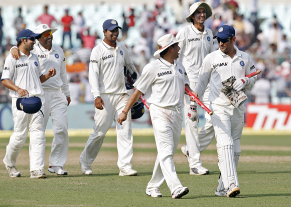 (L-R) Gautam Gambhir, Virender Sehwag, Pragyan Ojha, Sachin Tendulkar, Ishant Sharma and captain Mahendra Singh Dhoni walk back to the pavilion after India won the second Test