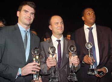 James Anderson, Jonathan Trott and Courtney Walsh with their awards