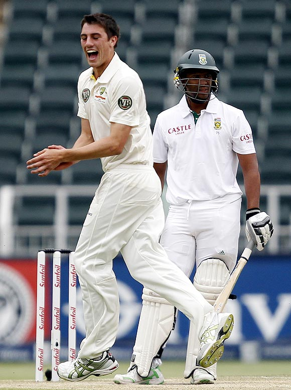 Australia's Patrick Cummins celebrates the dismissal of South Africa's Vernon Philander (right)