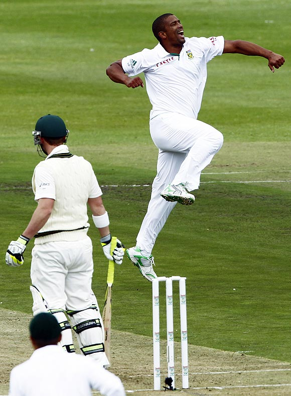 South Africa's Vernon Philander (right) celebrates after dismissing Australia's Phil Hughes