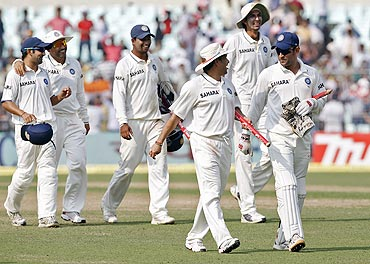Members of the Indian team walk off the field after winning the 2nd Test in Kolkata