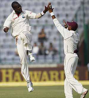 Sammy celebrates with Chanderpaul
