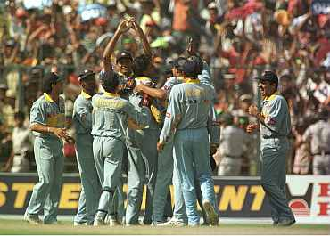Indian team celebrates after a fall of a wicket during the 1996 World Cup