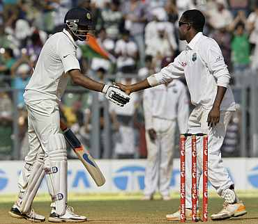Darren Bravo congratulates R Ashwin after his century