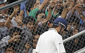 Sachin Tendulkar walks back after missing his century at the Wankhede on Friday