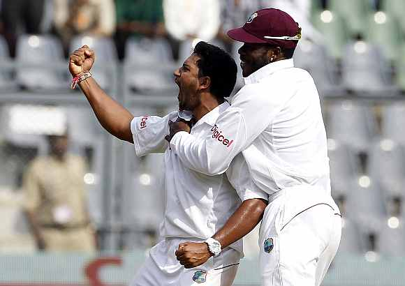 Ravi Rampaul celebrates after picking Sachin Tendulkar's wicket