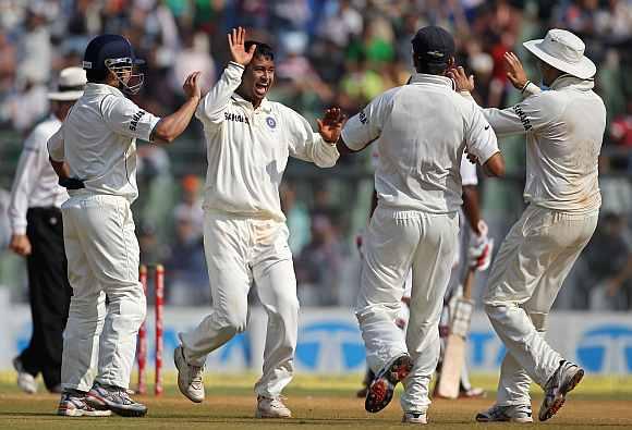 Pragyan Ojha celebrates after picking up a wicket