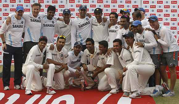 Indian team pose for photographers with the winners trophy