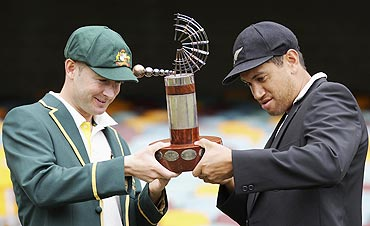 Australia's captain Michael Clarke (left) and New Zealand's captain Ross Taylor hold the Trans Tasman Trophy