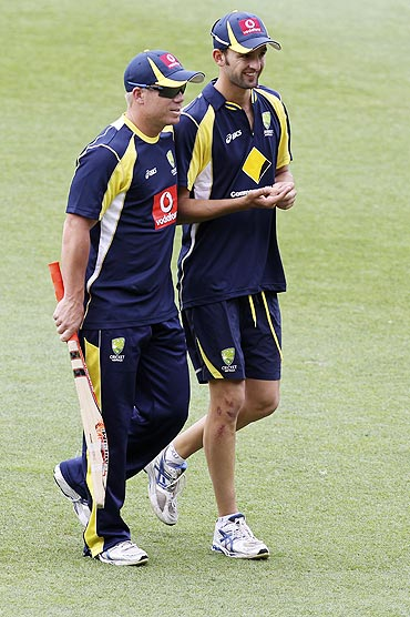Australia's David Warner (left) and Nathan Lyon walk to the nets on Wednesday