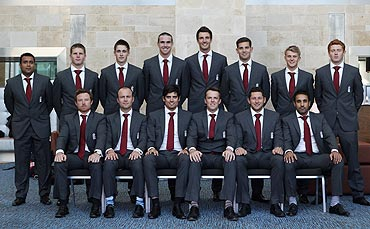 The England team poses for a photograph before departure for India