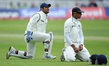 Mahendra Singh Dhoni and Rahul Dravid look glum